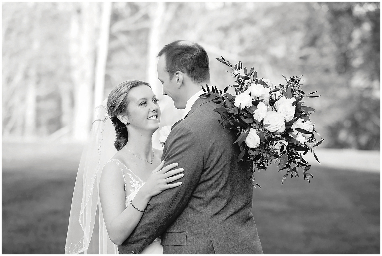 black and white image of couple looking at each other