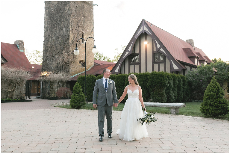 bride and groom in front of St. Clements Castle