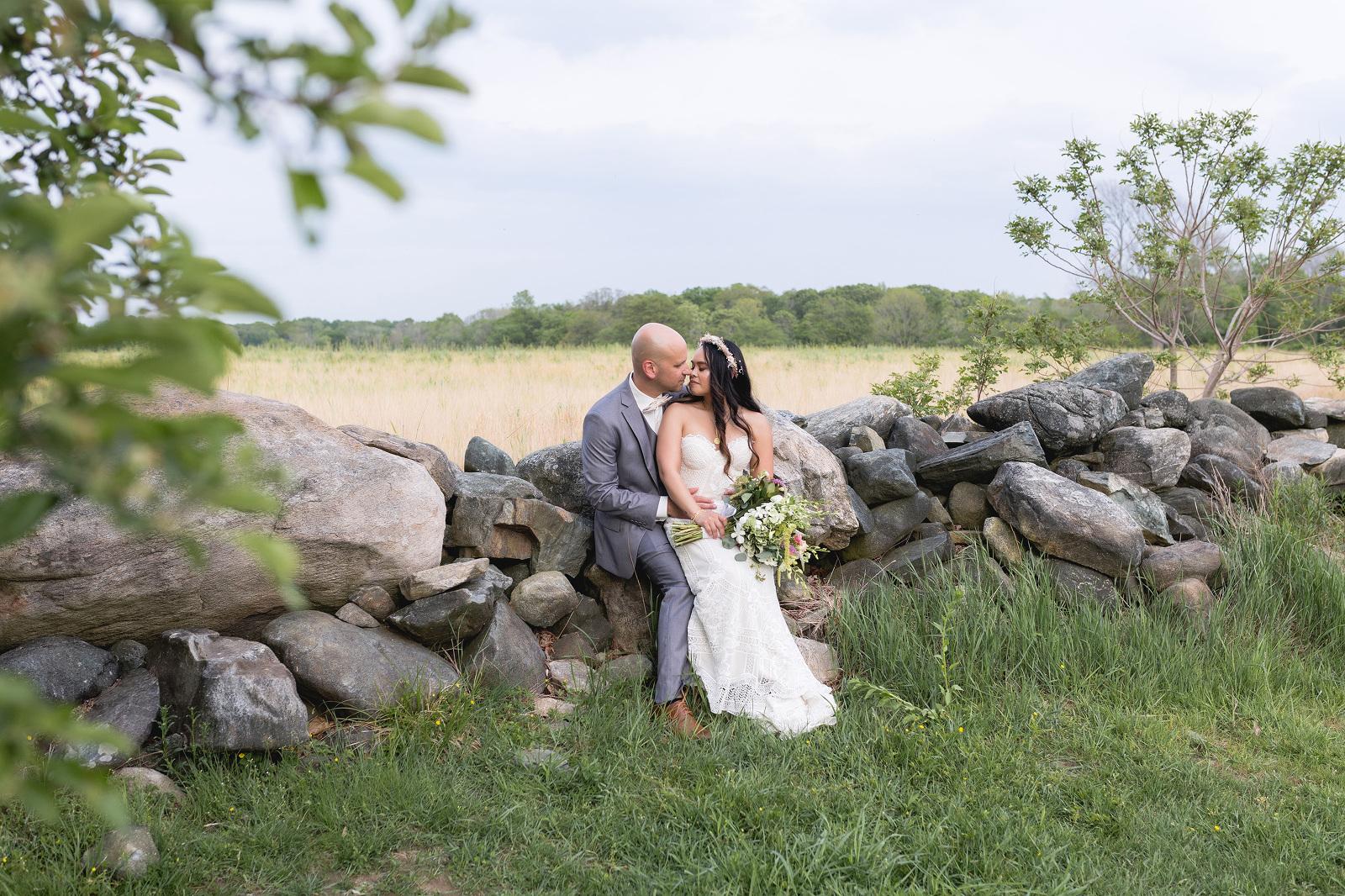 bride and groom jonathan edwards winery rock wall